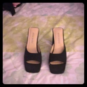 Black high heeled mules